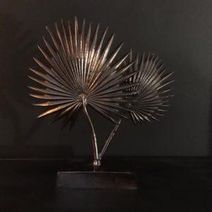 Statue feuilles de palmier argentees