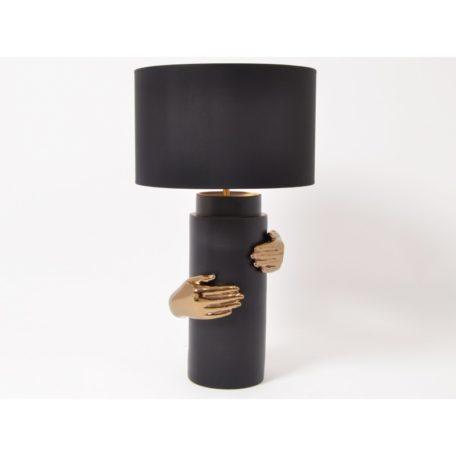 Lampe FEMINA en ceramique noire avec mains or.